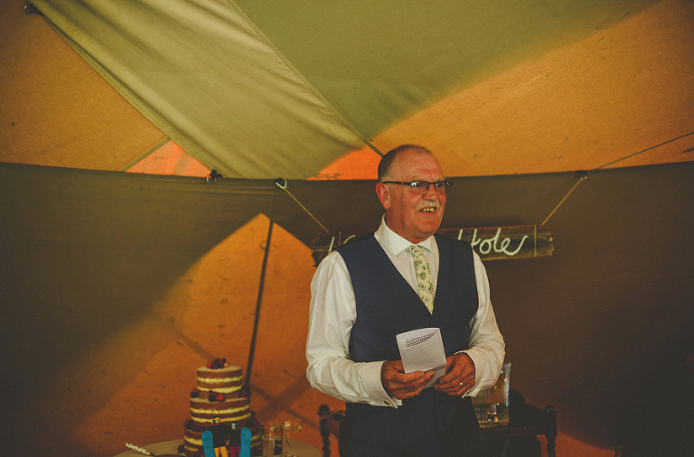 The brides father delivers his speech in the tipi