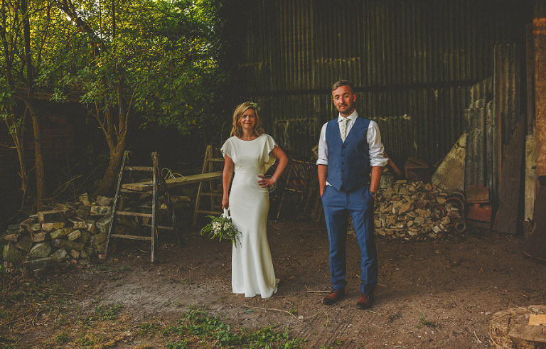 The bride and groom in the old barn