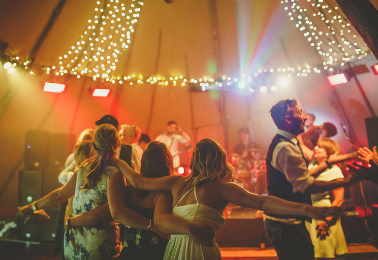 The bridesmaids dancing in the tipi
