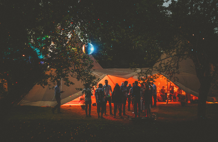 Guests gather outside the tipi