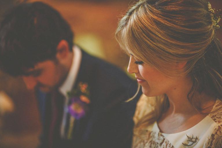 The wedding couple take their vows