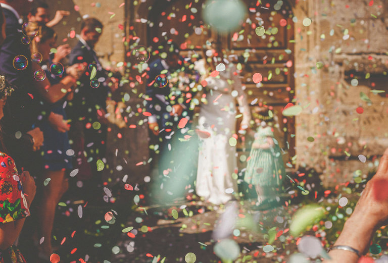 Wedding petals fall to the ground