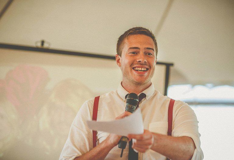 The best man tells everyone in the marquee who he is