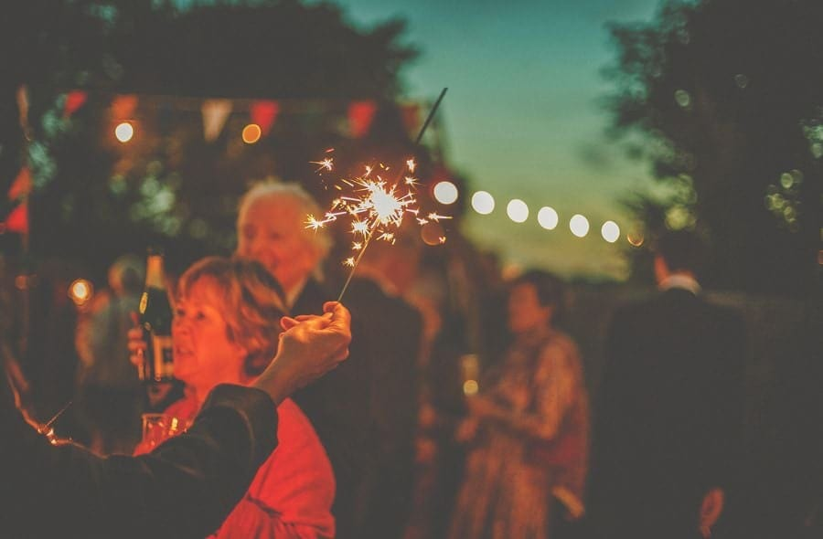 A sparkler is waved around outside