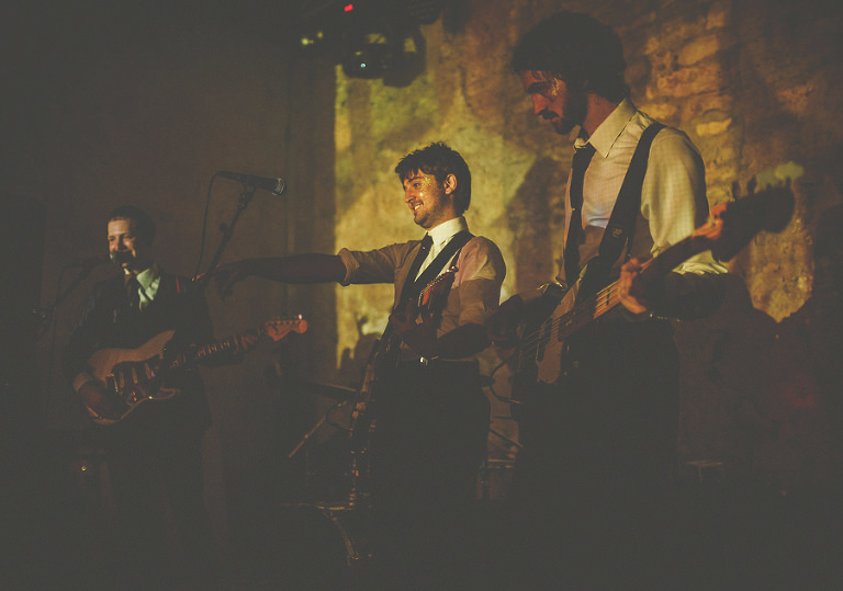 The wedding band perform live on stage at Penny Square Barn