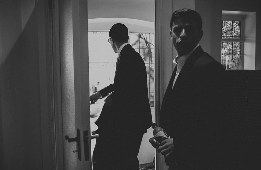 The groom and his brother open the door and leave the house