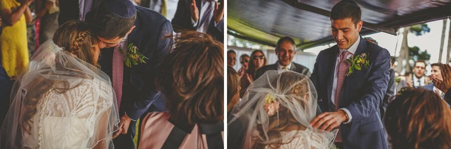 The groom bends down and kisses the bride