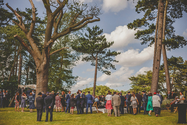 Wedding guests gather together for the outdoor jewish ceremony
