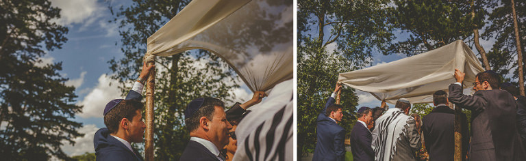 Wedding guests hold up the chuppah for the outdoor jewish wedding ceremony