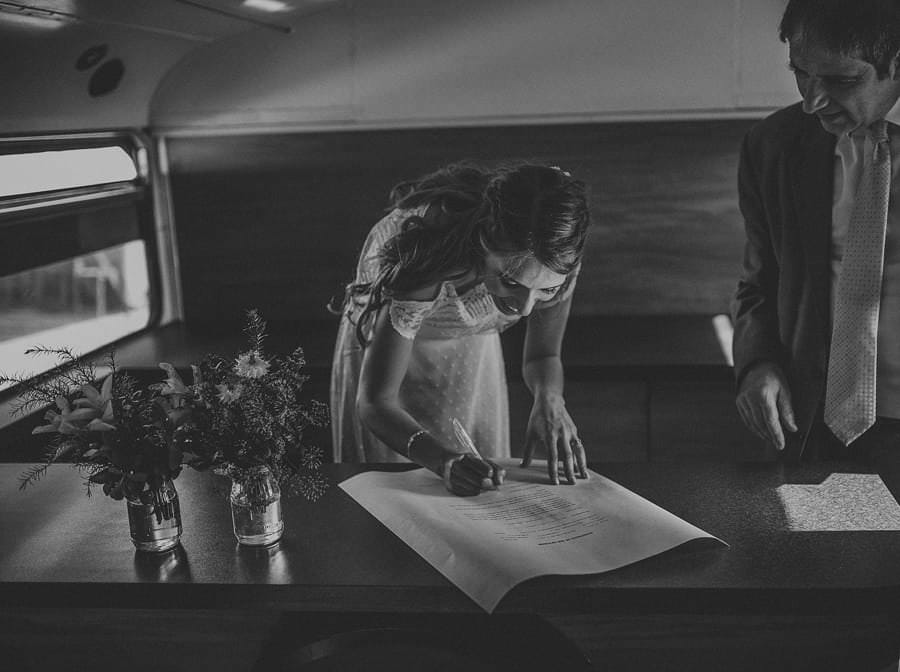 The bride signs her wedding documents