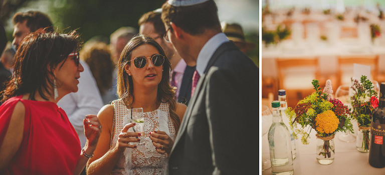 Wedding guests talk to each other on the lawn at brook farm