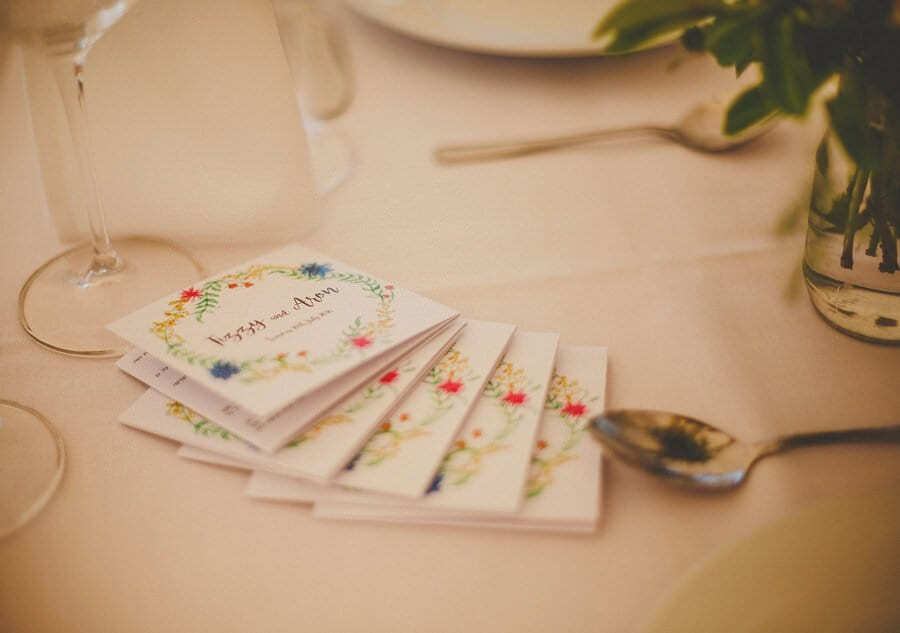 Wedding invitations on the table in the marquee at brook farm