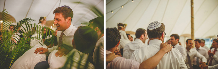 The wedding guests put the groom down in the marquee