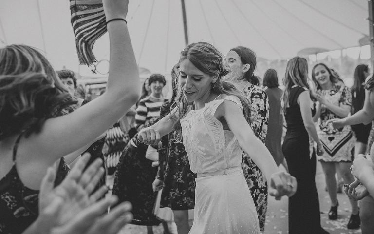 The bride dances on the dancefloor in the marquee at Brook farm