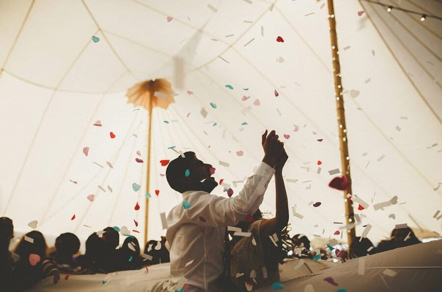 Confetti is fired across the air in the marquee
