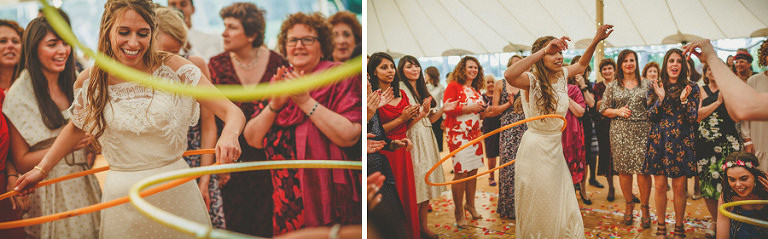 The bride spins hoops around her hips on the dancefloor in the marquee