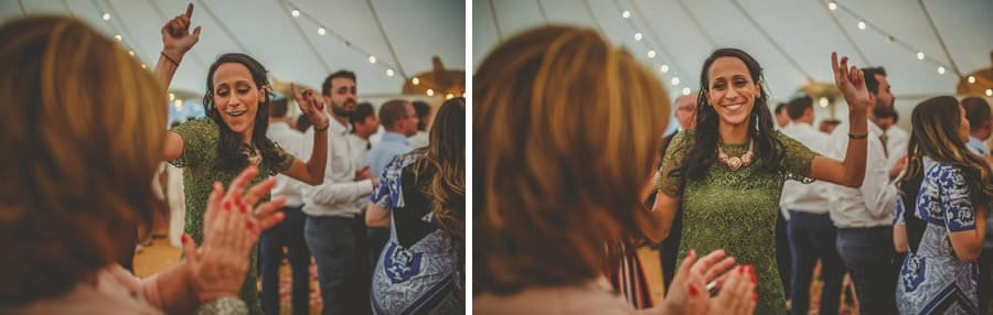 The brides sister dances on the dancefloor of the marquee