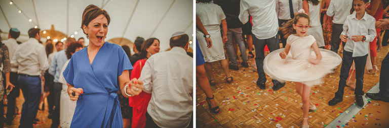 A girl spins around on the dancefloor in the marquee