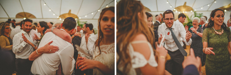 Wedding guests embrace each other on the dancefloor