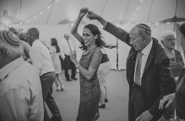 The brides sister dances with her grandfather on the dancefloor