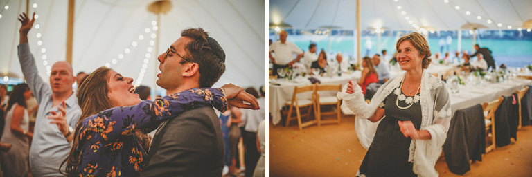 A husband and wife dance together on the dancefloor in the marquee