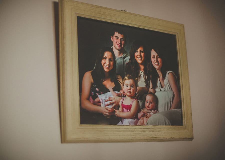 Family portrait on the wall of the house