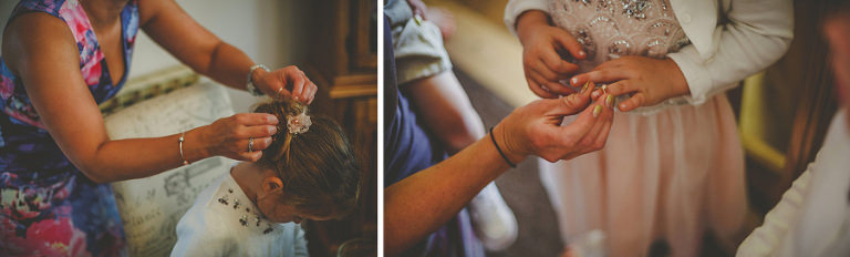 A flower girl puts on her ring