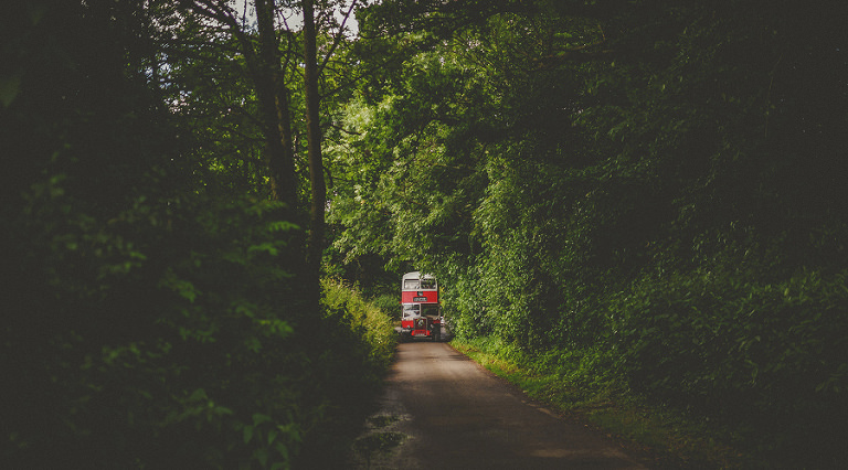 The wedding bus driving down a country lane