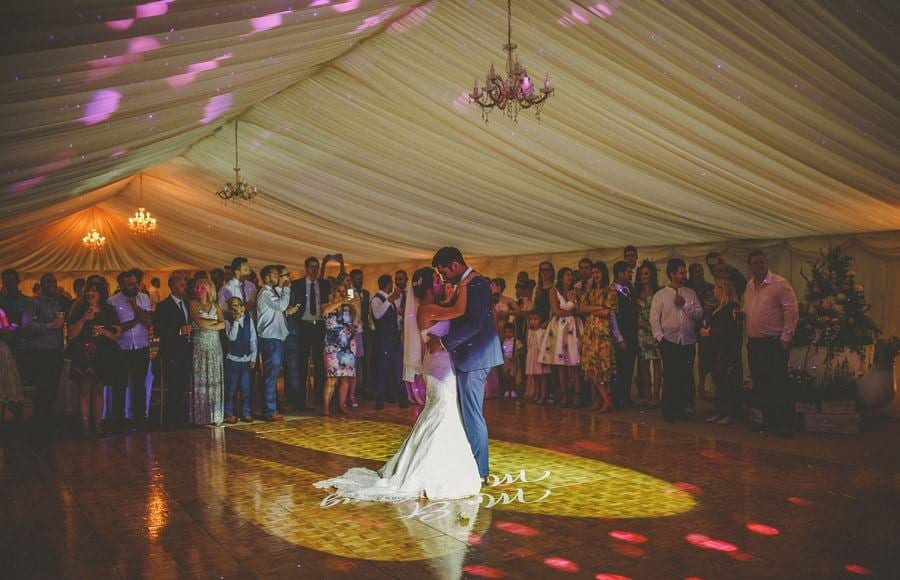 The bride and grooms first dance in the marquee at the old bridge petherton