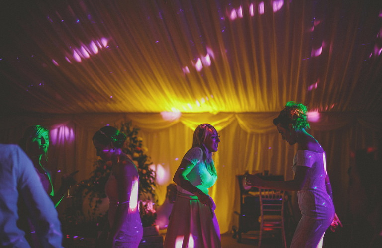 A bridesmaid on the dancefloor in the marquee
