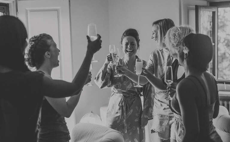 The bride and her bridesmaids make a toast with champagne