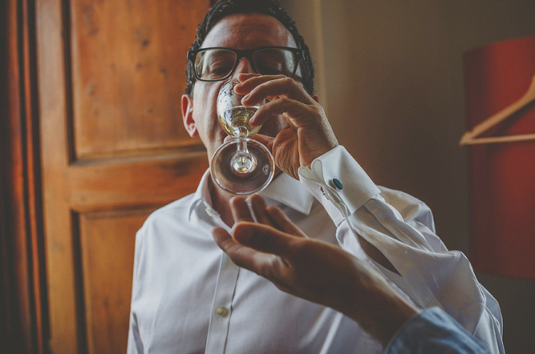 The groom drinking champagne