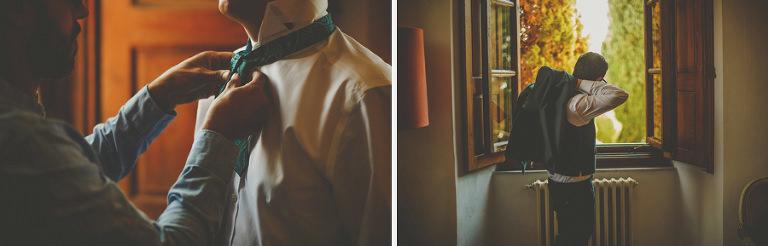 The groom puts on his jacket in Villa Di Ulignano