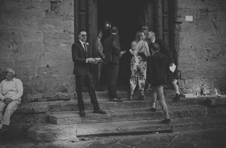 Guests enter the building at Palazzo dei Priori