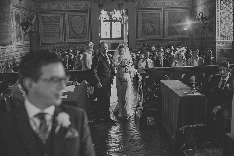 The bride and her brother enter the room at Palazzo dei Priori