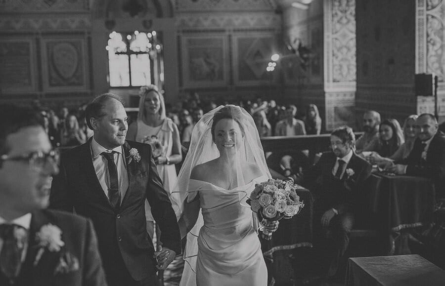 The bride walks down the aisle at Palazzo dei Priori