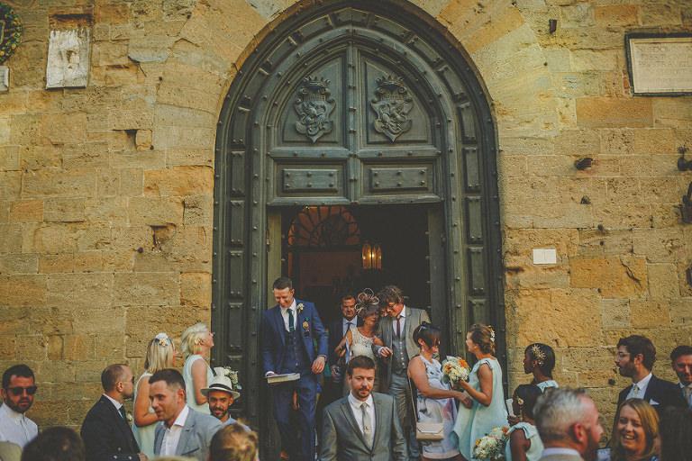 Wedding guests leaving Palazzo dei Priori