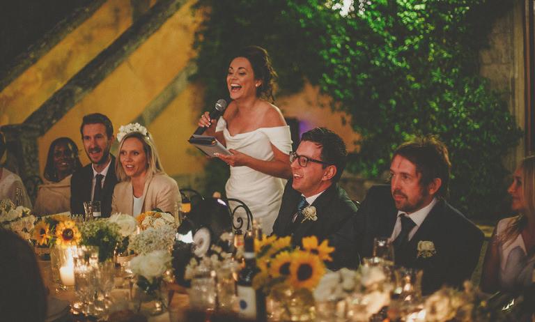 The bride laughs as she delivers her speech at Villa Di Ulignano