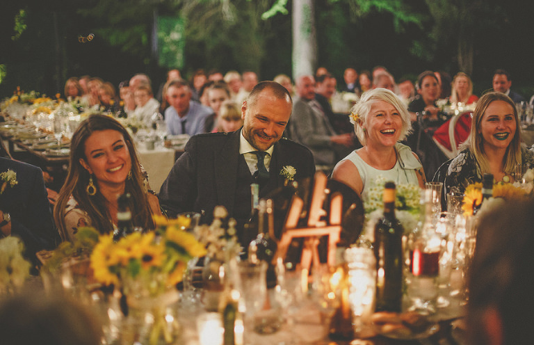Wedding guests laugh at the bridesmaids speech