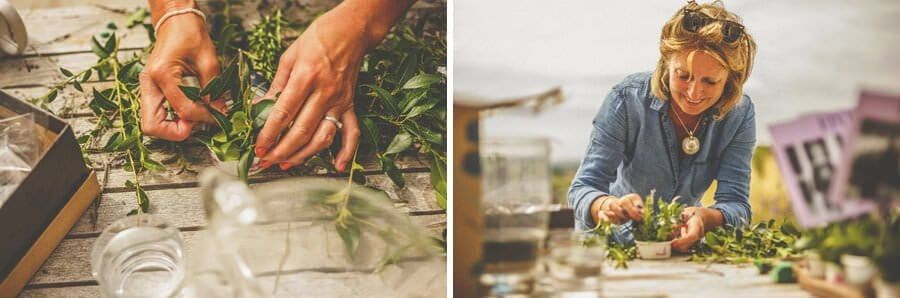 A lady wraps wild flowers on a wooden table outside