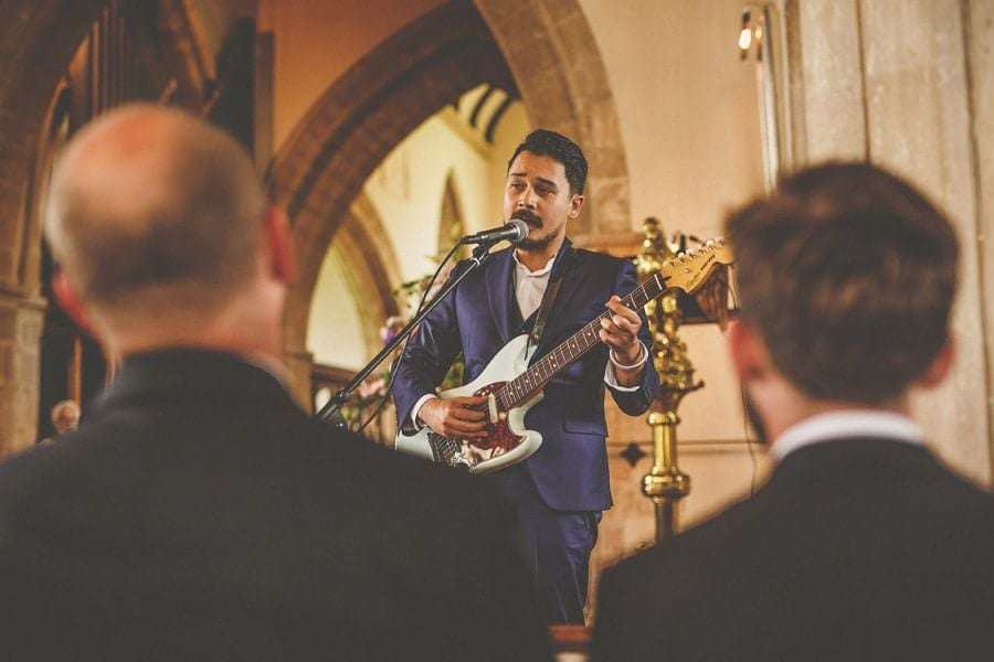 One of the wedding guests plays a song in church