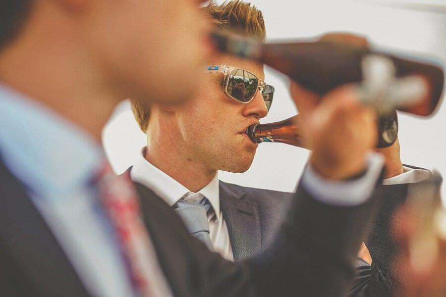 Wedding guests drinking bottles of beer