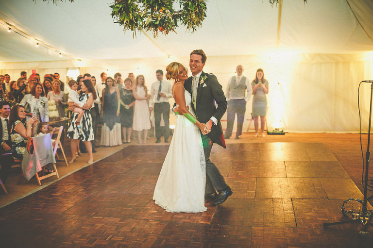 The bride and grooms first dance in the marquee