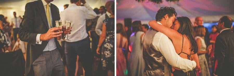 Glasses of champagne being carried across the dancefloor