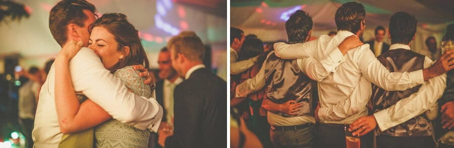 The ushers embrace each other on the dancefloor