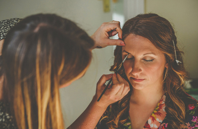 Bride having her make up applied in the morning