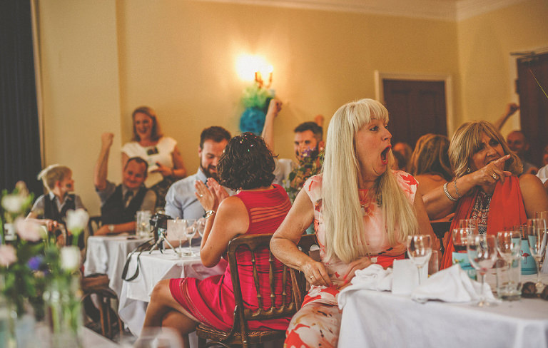 A wedding guest laughs at the speech