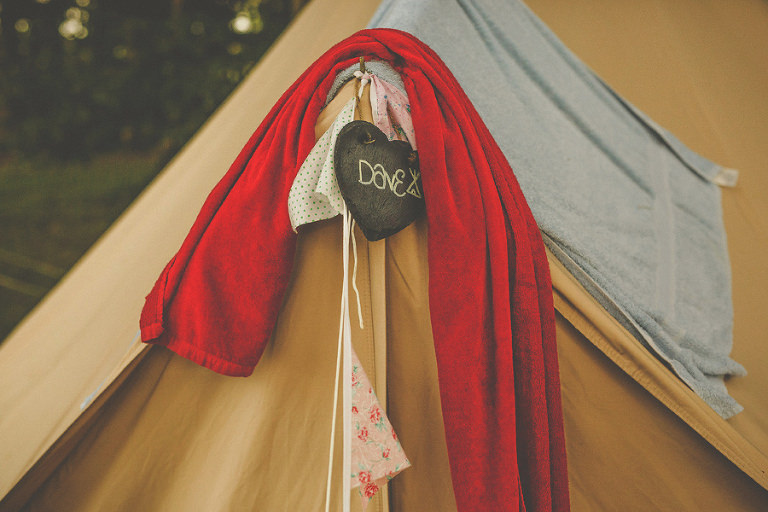 A tent with a red towel hanging from the front