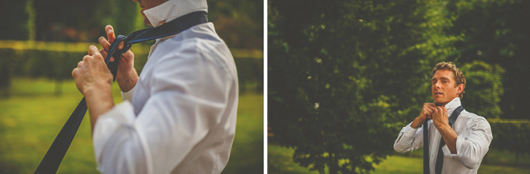 A man puts on his tie in the camping fields
