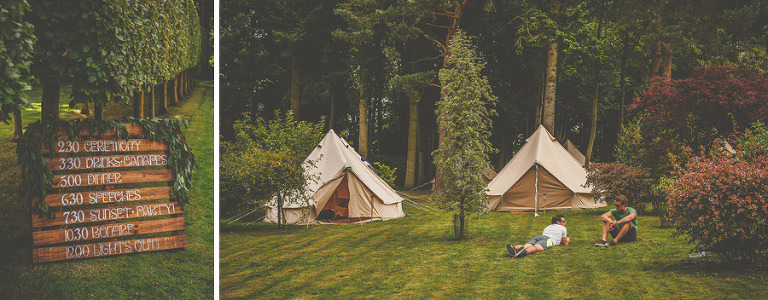 Two men lie on the lawn chatting to each other in the camping fields